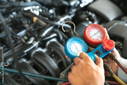 monitor tool on car engine ready to check and fixed car air conditioner system in car garage - 217622656