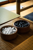 WeiQi, baduk or GO - black and white stone. traditional asian board game