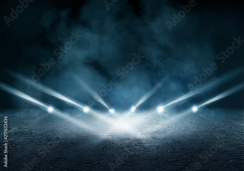 Background of an empty dark room. Empty walls, lights, smoke, glow, rays - 217632636