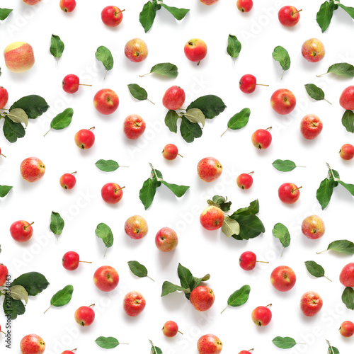 Seamless pattern of fresh red  apples with green leaves isolated on a white background, top view, flat lay. Food texture. - 217634843