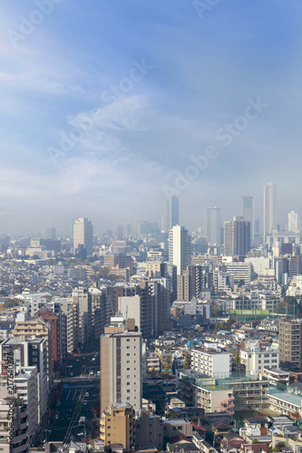 Sticker cityscape of tokyo city skyline from  skyscraper view, modern business office building with blue sky background in Tokyo metropolis city, Japan.