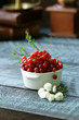 Quadro red currant in a cup on a wooden table