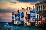 Traditional houses over the sea on a Mykonos island at sunset, greek little Venice - 217655093