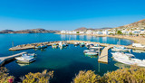 Motorboats and fishing boats anchored in harbour near the beach at sunny weather, Paros, Greece - 217661656