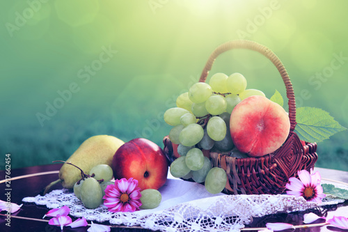 Leinwanddruck Bild Fruit basket isolated on green background. Nature background.
