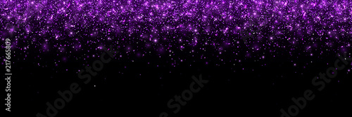 Purple glittering particles on black background, wide banner. Vector © lavabereza