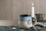 Mug Of Hot Chocolate. Burning Candle. Christmas Decorations.