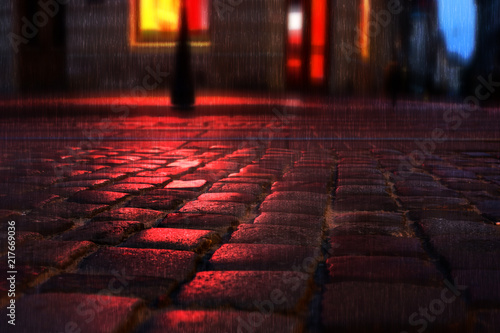 Sticker Old European illuminated city at rainy night