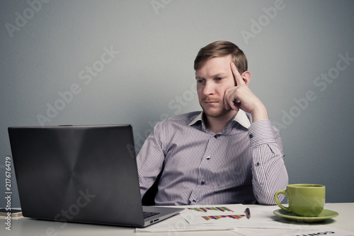 Fridge magnet Young businessman working with laptop at office