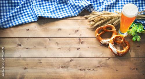 Oktoberfest background with Bavarian flag, beer glass and pretzel - 217680201
