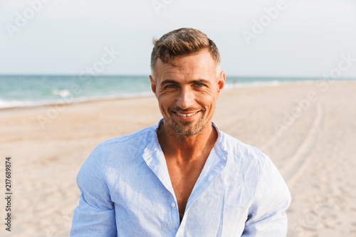 Portrait of a handsome smiling man in shirt