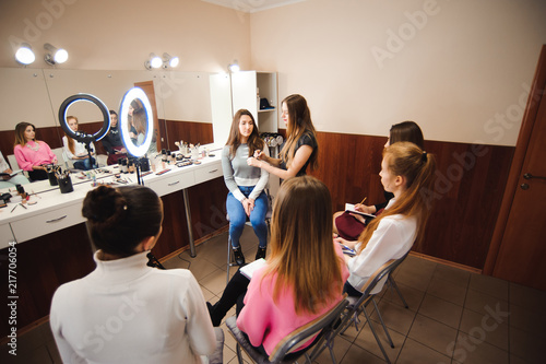 Leinwanddruck Bild professional makeup teacher training her student girl to become makeup artist. Makeup tutorial lesson at beauty school. Master class. Real people.