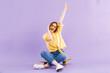 Leinwanddruck Bild - Portrait of a positive young girl in headphones