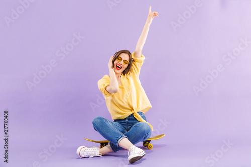 Leinwanddruck Bild Portrait of a positive young girl in headphones