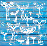 Set of Whales Tail on Rustic Wood Blue Background
