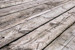 White boardwalk of stripped weathered washed out wooden planks with scratches. Abstract natural texture background - 217724010