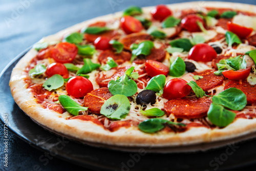 Fototapeta Sausage Pizza with Ham and tomatoes