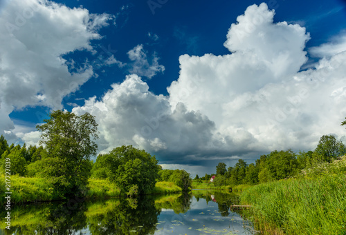 Canvas Zomer River is summer landscape. Sunny day, blue sky with beautiful clouds.