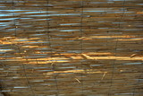 Stylish gold, yellow bars, banded sticks and straw sticks against the blue sky