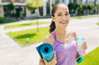 Healthy lifestyle. Delighted nice woman smiling while leading healthy lifestyle