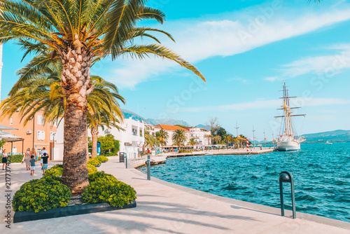 panoramic view of resort city at seaside with big white ship in port - 217737425