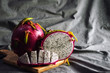 Organic Dragon Fruit or Pitahaya on Wood Plate with Crumpled Texture Background