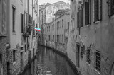 Monochrome Venice canal photograph with bright vivid tricolore italy flag