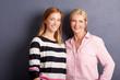 Beautiful mother and daughter studio shot