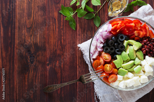 Foto Murales Bowl of vegetable salad with avocado and cheese