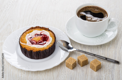 Foto Murales Cake with cream, strawberry jam, sugar,coffee, spoon on table