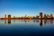 Upper Manhattan skyline view with reflection in lake and in sunset lights during the fall autumn season. Central park in New York, NY, USA