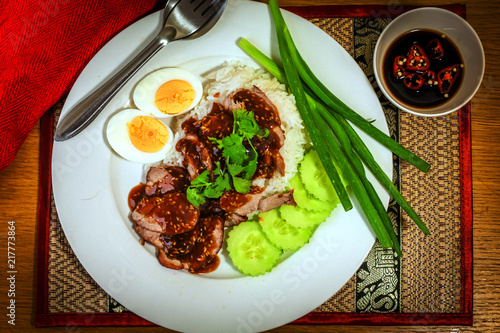 Foto Spatwand Thailand Thai red pork with egg, cucumber, spring onion, rice and a dark sauce