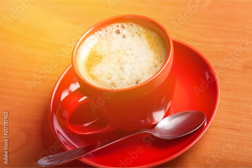 Wall mural Coffee cup on desk