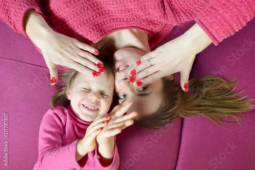Leinwandbild Motiv Mom and daughter having fun together