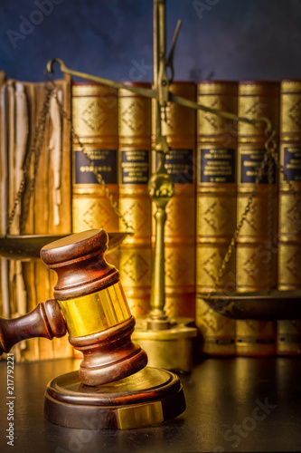 Naklejka Law and justice concept - law gavel with row of books, retro toned