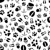 Animal and bird track seamless pattern background