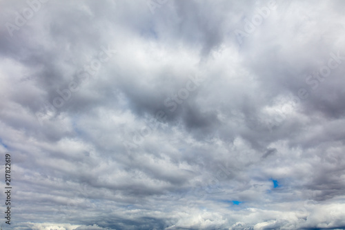 Foto Murales Clouds before the rain as a background