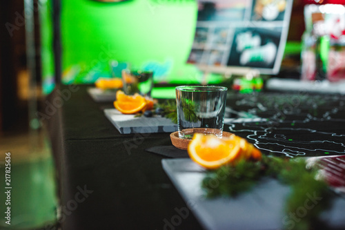 Aluminium Sap decorative serving, table setting for a coffee drink. slices of citrus oranges and a glass beaker