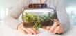 Businesmann holding a Digital vegetal plant connected