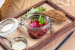 Steak Tartare with bread toasts - 217833244