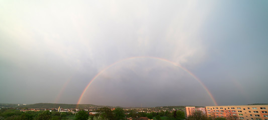 The rainbow above the city