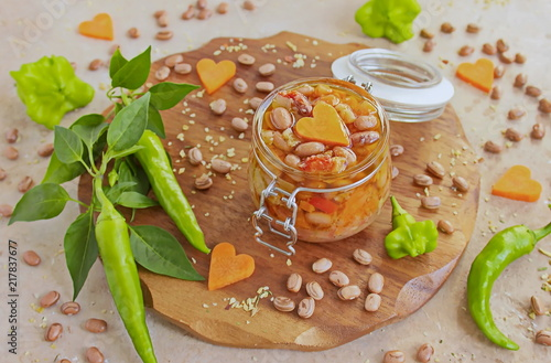 Salad with beans in a jar and vegetables prepared in a jar. Homemade canning winter preserve - 217837677