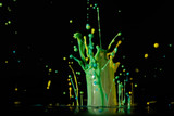 Abstract sculptures of colorful splashes of paint. Dancing liquid on a black background. Ink water splash. Color explosion. - 217838080