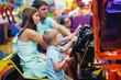 Quadro Cute girl plays a rifle shoots arcade in game machine at an amusement park.