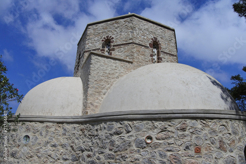 Foto Spatwand Santorini Kuppel mit Glockenturm des Kloster Moni Profiti Ilia auf Santorin