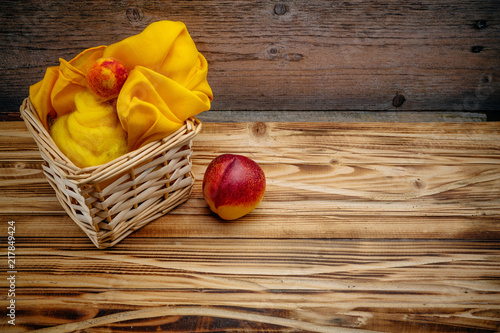 Foto Murales Nectarine and peach from felted wool with a basket