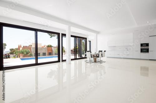 Foto Murales White empty room with green landscape in window.