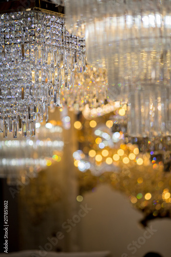 Background of glitter, colorful bokeh, chandeliers, crystal, chandelier , Emphasis on luxury, used in various places such as palace church, residence. - 217851602