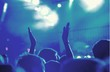 Audience with hands raised at a music festival and lights - 217855693
