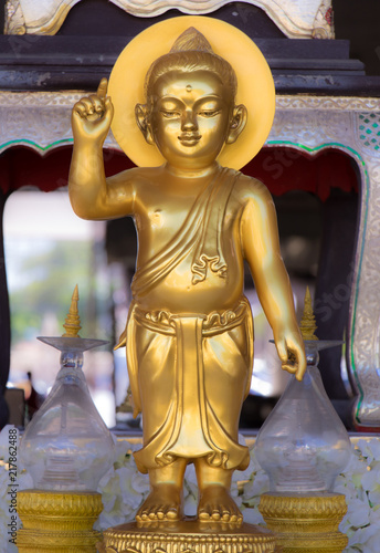 Foto Spatwand Boeddha The golden statue of Buddha in Buddhist monastery, Thailand. Boy Buddha.